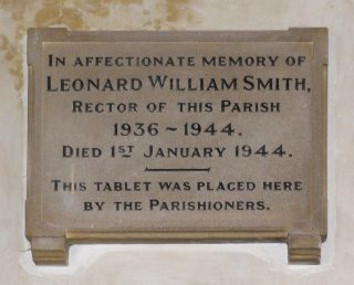 Memorial plaque to Rev. Smith, mounted in the Chancel at St John the Baptist's, Muston. | Bottesford Archive