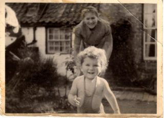 Timothy Doncaster and mother in Field View's  rear garden  | From the collection of Tim Doncaster