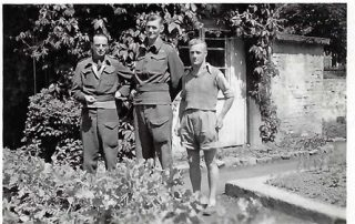 A.C.Wright, the centre of three POWs photographed at Oflag IX a/h (1944) | Copyright Dr Rebecca Matthews